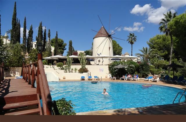 If your staying at Los Molinos this is the communal pool. It is heated, they are lots of sun loungers to relax on. A smaller pool for younger children and the windmill is a great place to eat, PERFECT.  www.la-manga-apartments.com