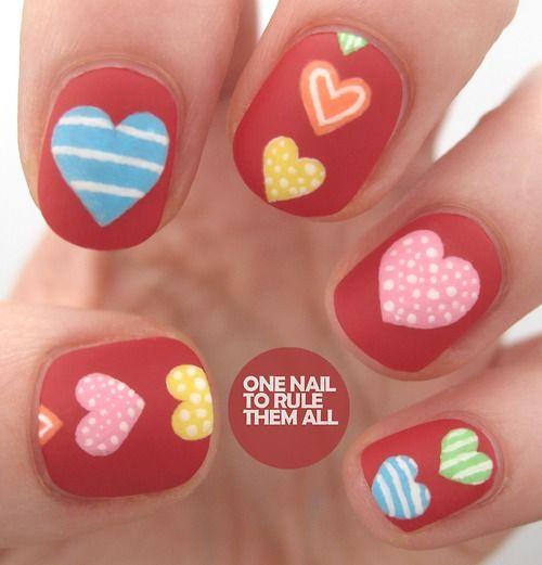 onenailtorulethemall:  My first set of valentines day nails...