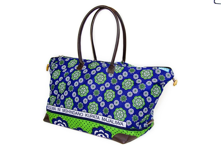 Funky blue, green floral print 'kanga' bag with a leather base and handles for durability, strength and comfort. It features a unique swahili print on the side and has a strong zipper and a small inside pocket. The toggle detail on the sides, allow you to adjust the size to suit your use.    Approximate sizes,     Large Bag: 70cmx60cm. Leather base 27cmx48cm. Handle height 28cm.    Small Bag: 55cm x 52cm. Leather base 19cmx38cm.  Handle height is 28cm.
