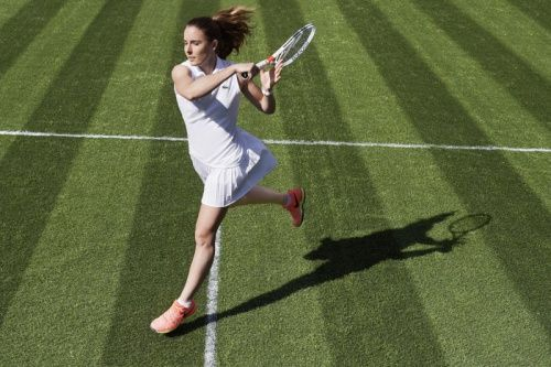 Alize Cornet's white #Lacoste polo and leightweight pleated skirt for #Wimbledon 2017