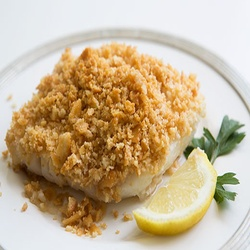 Baked Cod With Ritz Cracker Topping. Dad makes me this every year for my birthday. With a white sauce. Yum.