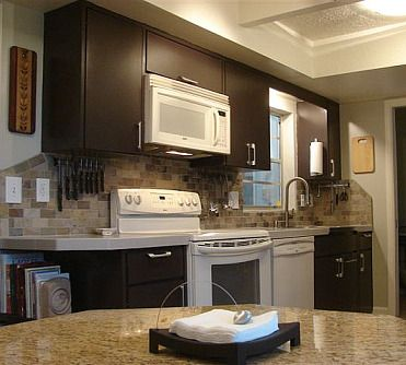 Dark cabinets with white appliances and stone backsplash for Kitchen with white appliances and dark cabinets