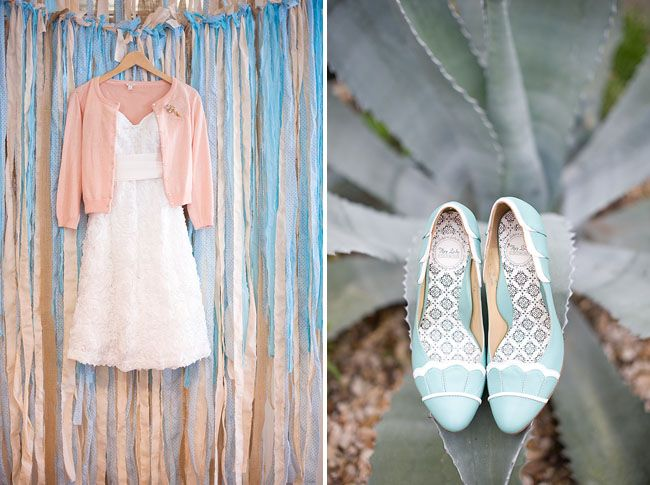 A pink cardigan and pale blue shoes.