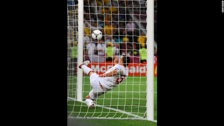 John Terry of England clears an effort from Marko Devic of Ukraine off the line during the match between England and Ukraine. CNN.com