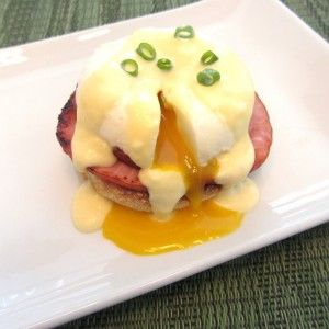 Classic Eggs Benedict - English Muffin, Canadian Bacon, topped with ...