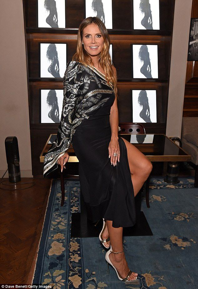 Turning heads: Oozing glamour as she prepared to meet her fans, the 43-year-old model was ...