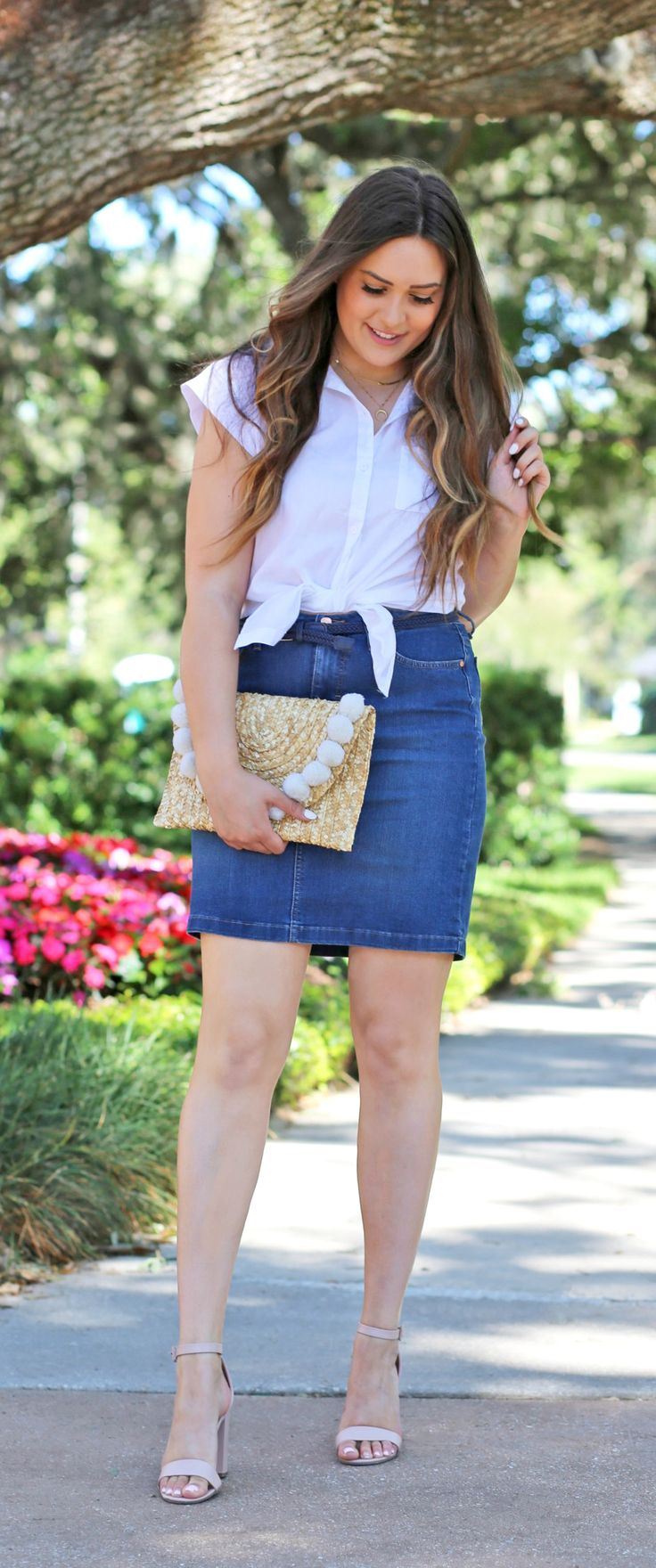 708eb454d Orlando fashion blogger Michelle Kehoe from Mash Elle shares how to style a  denim skirt during spring and summer! She styles the skirt with a white ...