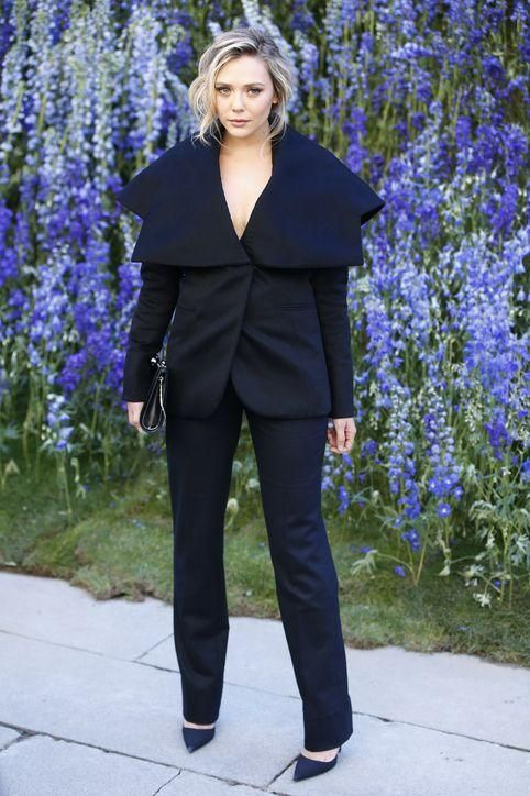 Elizabeth Olsen was at the Dior spring 2016 show in Paris today wearing a sharp black suit. Click for more pics!