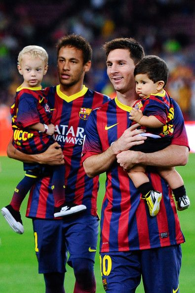Neymar of FC Barcelona with his son Davi Lucca (L) and his team-mate Lionel Messi of FC Barcelona with his son Thiago walks out the pitch priot to the La Liga match between FC Barcelona and Real Sociedad de Futbol at Camp Nou on September 24, 2013 in Barcelona, Catalonia.