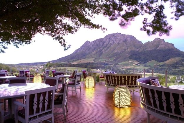 Delaire Graff Restaurant, Stellenbosch, South Africa  You're sitting: in the Cape Winelands  At: The Delaire Graff Estate  Looking at: Simonsberg Mountain Range and Estate vineyards  Eating: kabeljou fish or free-range beef with bone marrow and oyster mushrooms