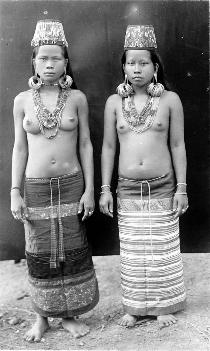 Indonesia ~ Kalimantan / Borneo | Two young Kayan women in 'festival' costume | Photographer Prof. A.W. (Anton Willem) Nieuwenhuis, date unknown, ©Tropenmuseum, Netherlands