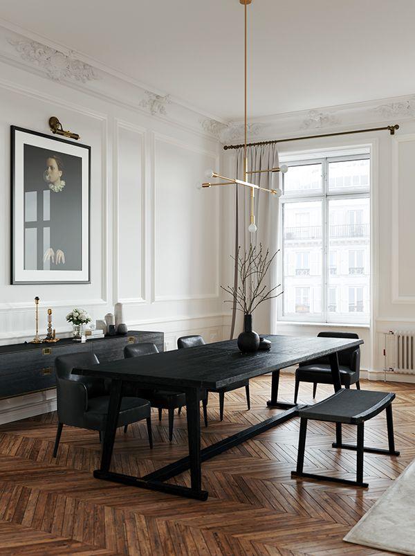 Salon d'un appartement haussmannien, parquet point de Hongrie, meubles noirs, suspension en laiton, moulures