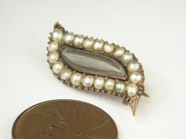 "Georgian-era pin, circa 1800's.  Shuttle or ""eye"" shaped."