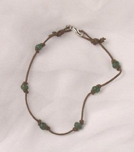 Anklet - Indonesian, Tradewind Beads Curious Designs. Save 5 Off!. $18.95. Very strong cotton cord.. Please see our apparel, ceramic and bead lines!. Bead color may vary slightly. (can be more aqua-green). Free shipping on orders over $75.00.. More anklets available.