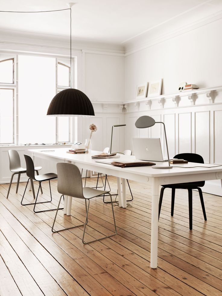 Muuto - Adaptable table designed by TAF Architects in a workplace setting.