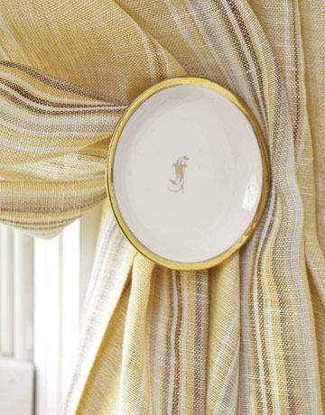 Creative Holdbacks  This easy DIY project gives sheer, striped drapes sophistication. Use antique butter pats, small plates used to serve butter, to make unique holdbacks by affixing a screw on the back.