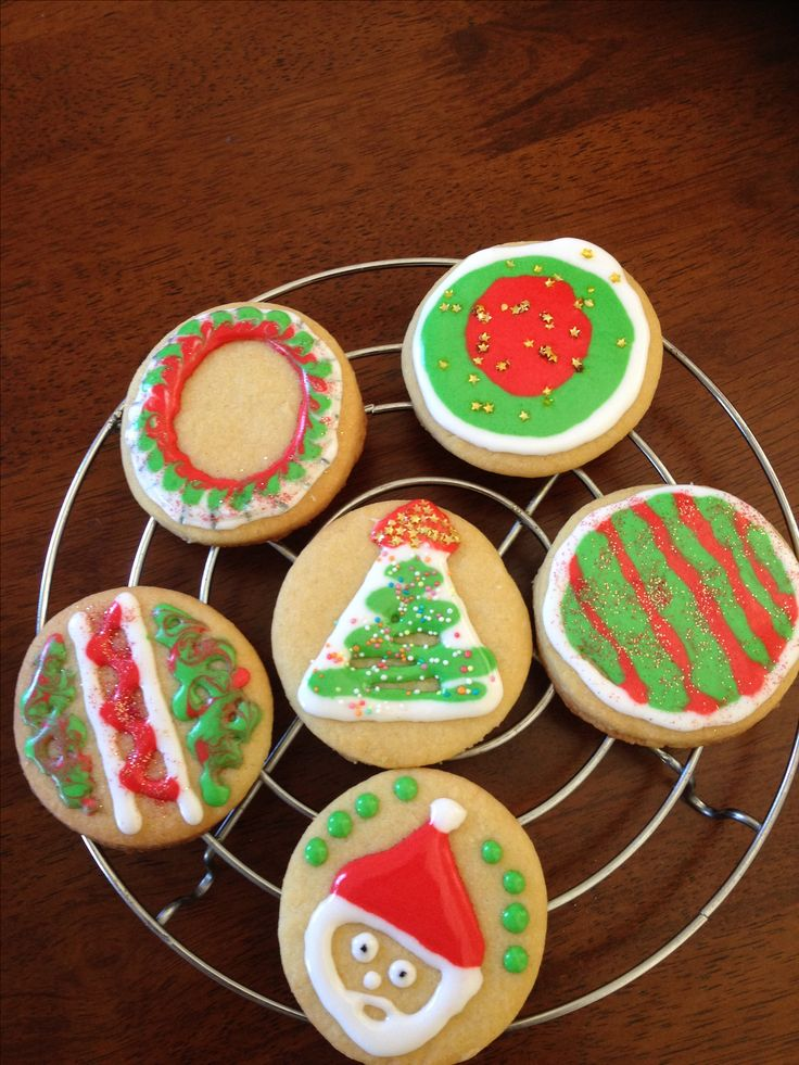 My first royal icing decorations. Christmas cookies. Not as easy as it looks. Thanks to Julia M Usher on YouTube for the tutorials.