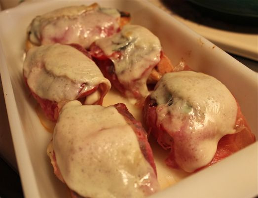 Prosciutto-wrapped chicken breasts. Topped with sliced tomatoes and ...