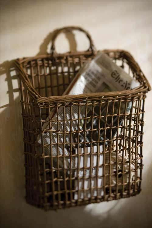 A nice wicker basket for corralling the mail