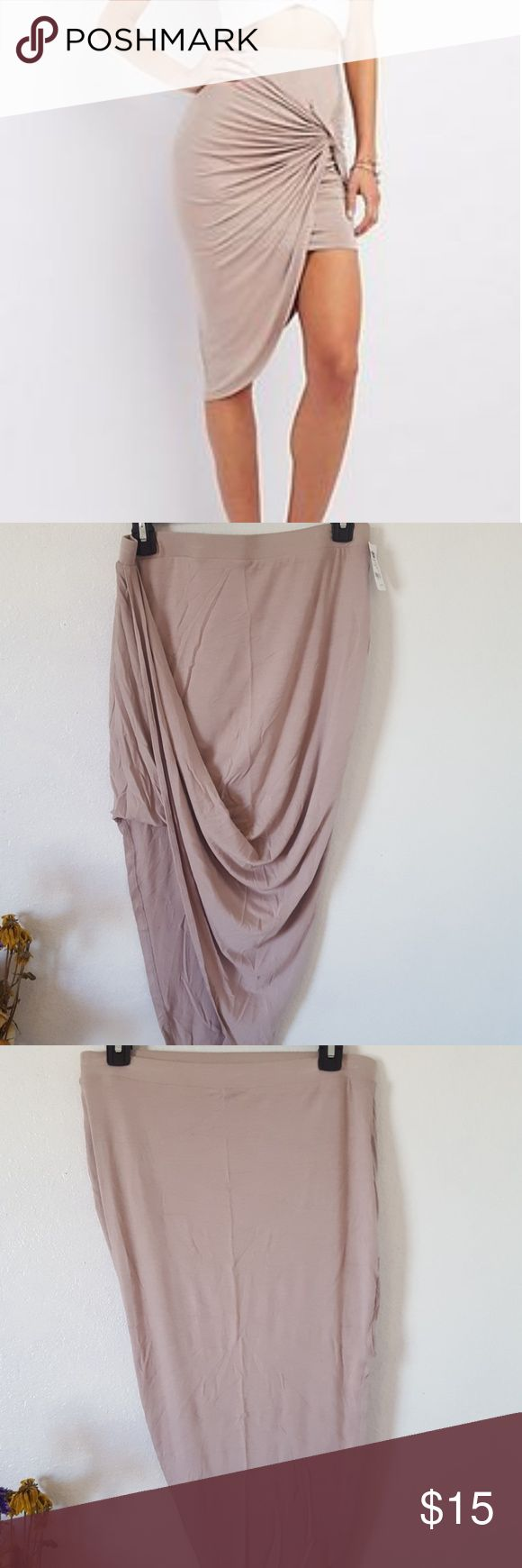 Skirt Similar to first picture, new, it has a pretty pinky nude mauve color, a little wrinkly since it's been in my closet, 95% rayon, 5% spandex Charlotte Russe Skirts