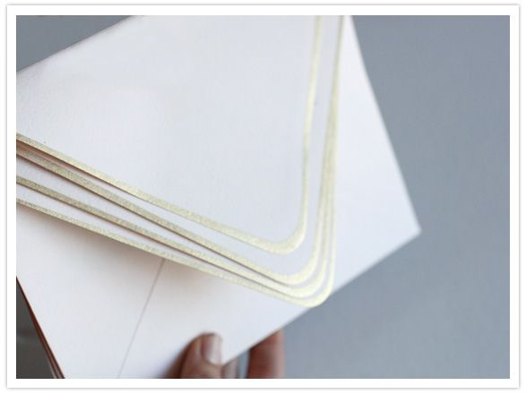 good idea! gold edged envelopes (they masked and spraypainted them -- I would probably use a leafing marker)