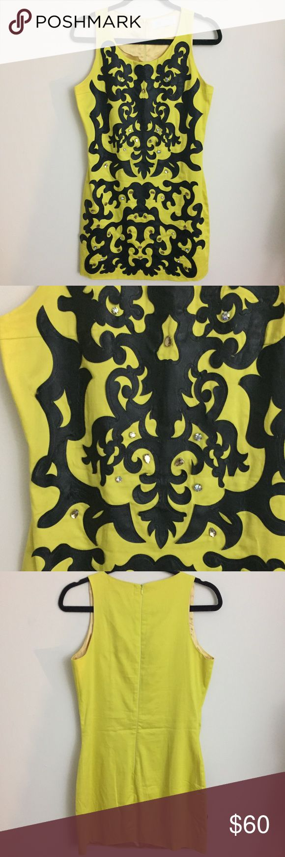 Leather embroidered dress 👗 Only worn once to a wedding - Like new! The embroidered pattern is made of leather and there are crystal applications around the front, adding even more glam. Very flattering and fitted dress. Dresses Mini