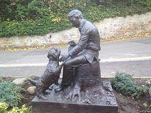 Statue of Robert Louis Stevenson as a child, outside Colinton Parish Church, Scotland