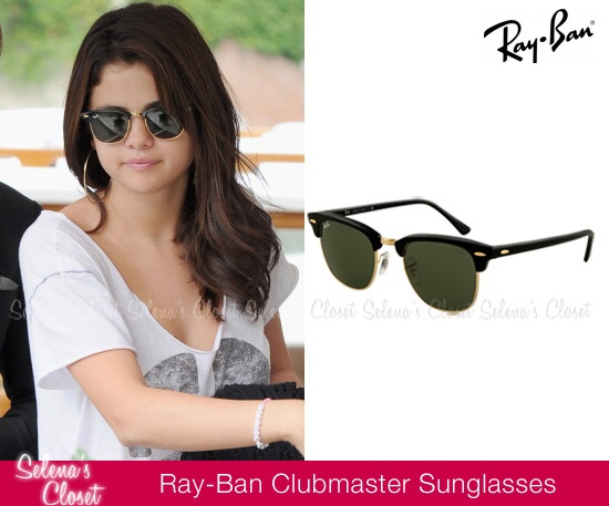 Selena Gomez arrived in Venice, Italy earlier today (September 4, 2012) where she will attend the world premiere of Spring Breakers tomorrow at the Venice Film Festival. She's pictured wearing these chic Ray-Ban Clubmaster Sunglasses (style RB3016-01 W0365). You can get them for $145 on Ray-Ban's official website.  Buy them HERE  She's wore these sunglasses with a Chaser tee, Steve Madden boots and Louis Vuitton bag