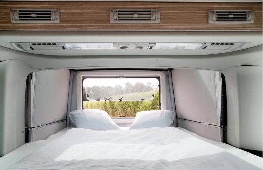 The slide-out bedroom has a large rear window