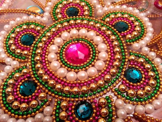 Traditional Indian Kundan art form rangoli / kolam design, which can float on water. Advantages of this Rangoli : - Ready to use - No mess of