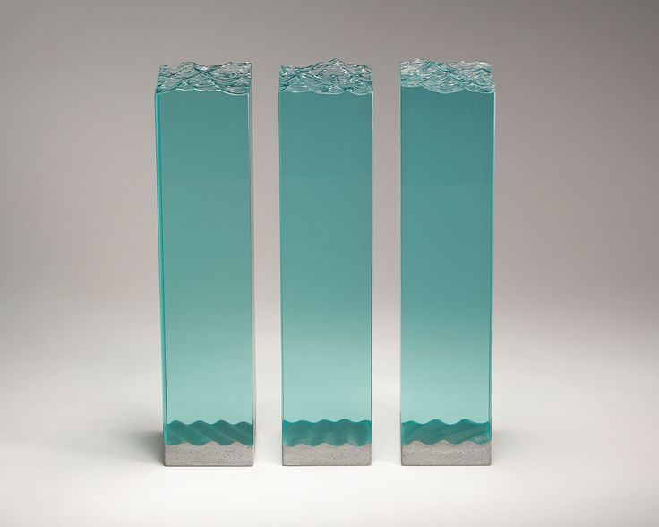 Laminated float glass and cast concrete. W120mm x D115mm x H530mm each tower.