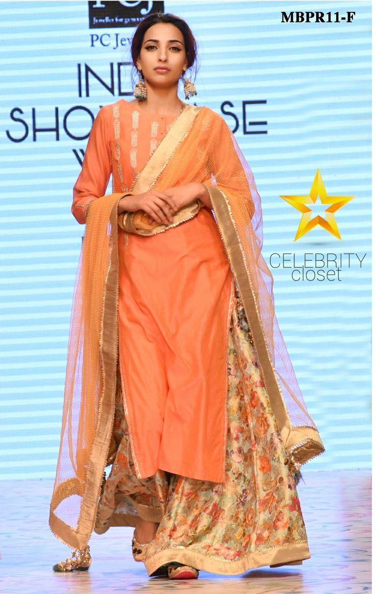 Traditional fashion and modern designs unify with this rose peach sharara set by Meena Bazaar,It consist of rose peach kurti in pure chanderi silk with badla zari detail on the bodice and gotta detail on the side slits that mark the beginning of a new fashion saga .It is paired with chanderi digital print sharara and net dupatta with foil dot all over.Color may slightly be different from the actual item due to photographic lighting sources or the monitor's settings.