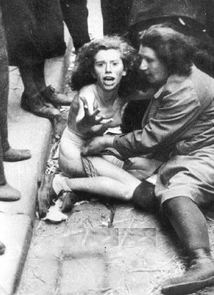 Jewish mother and daughter being humiliated in Germany during World War II. - 1941