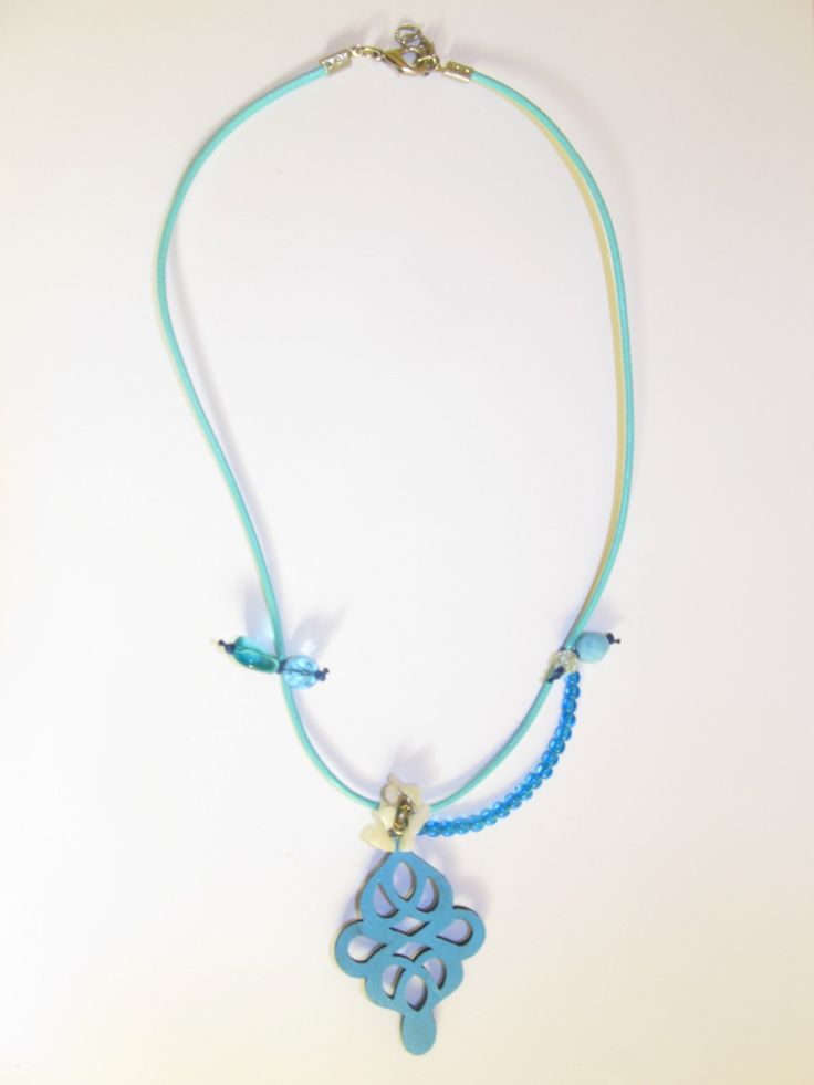Handmade short leather necklace (1 pc)  Made with turquoise leather filigree, aqua leather cord, glass beads and mother of pearl chips.