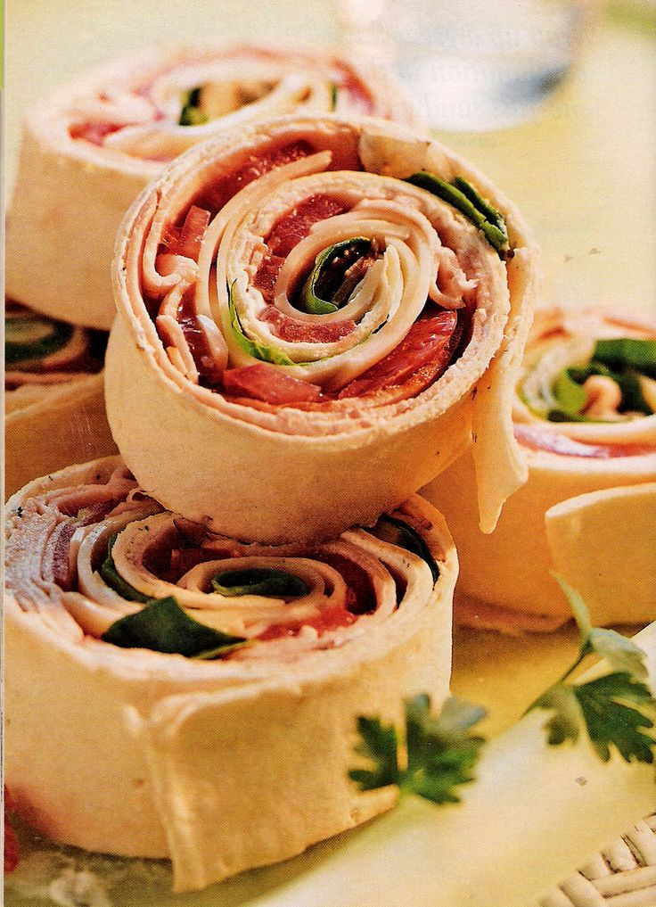 Picnic Party Food: Spread chive or sundried tomato cream cheese over large flour tortillas.  Place a slice of smoked ham over the tortilla.  Roll up, chill for an hour, and then cut into slices.