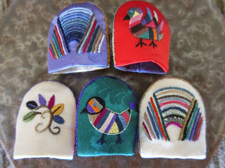 Korean thimbles hand embroidered and crafted by Kumjoo Ahn, a textile artist in USA(kjooahn@empas.com). They are collected by Becky Meverden.