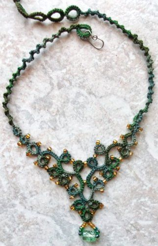 Jungle Green Necklace       This necklace was done in Lizbeth, size 3, Jungle Green.  The necklace is a great pattern for needle tatters to practice their directional tatting (hint, hint....students).