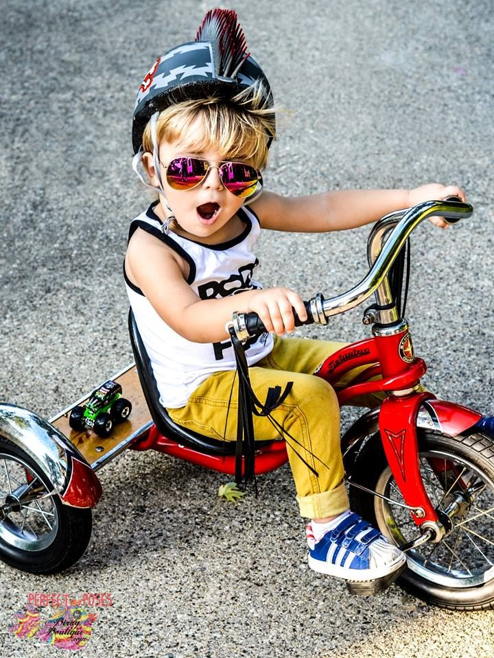 """Outdoors, 2 year old boy photo ideas, first bike, tricycle, so cool, bad boy, cyclist, spike helmet, adidas, tassles, monster truck, ray bans, sunglasses, long hair, tank top, summer, riding bicycle, play all day, lifestyle photography, natural light for children's photography. Check out some pics we captured using our own camera and a creative exploring eye for Perfect Poses by Birdy Boutique. Click the """"VISIT"""" button above for more photos!"""