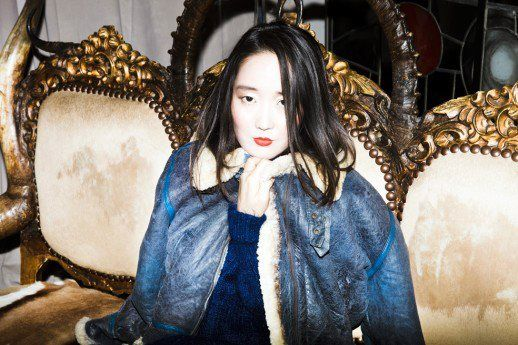 Shini Park wearing american vintage aviator jacket with 80's Laura Ashley polo neck dress