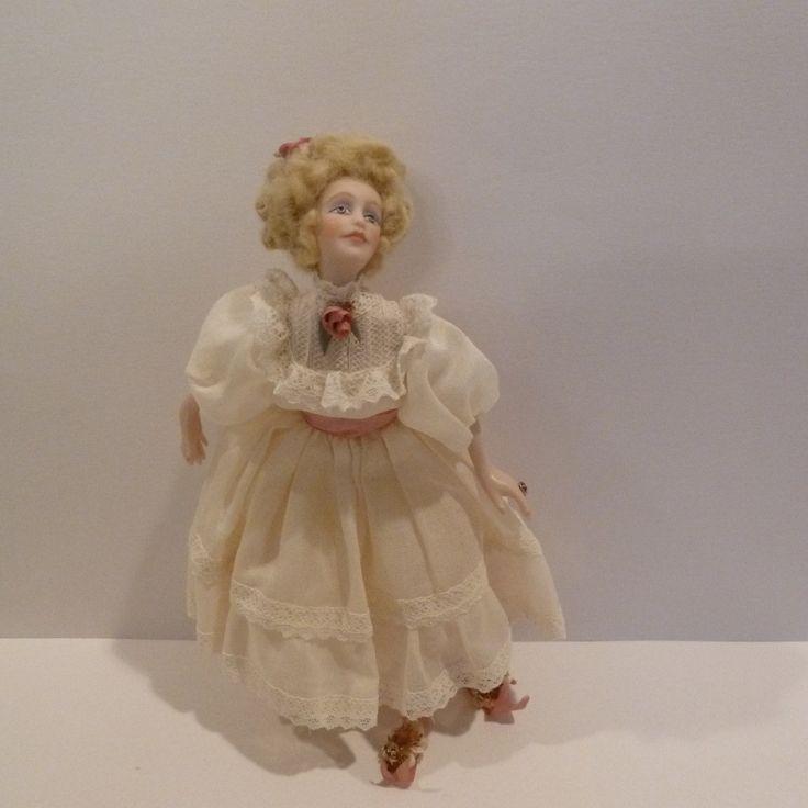Rosemary Tucker, IGMA fellow - costuming on porcelain woman -