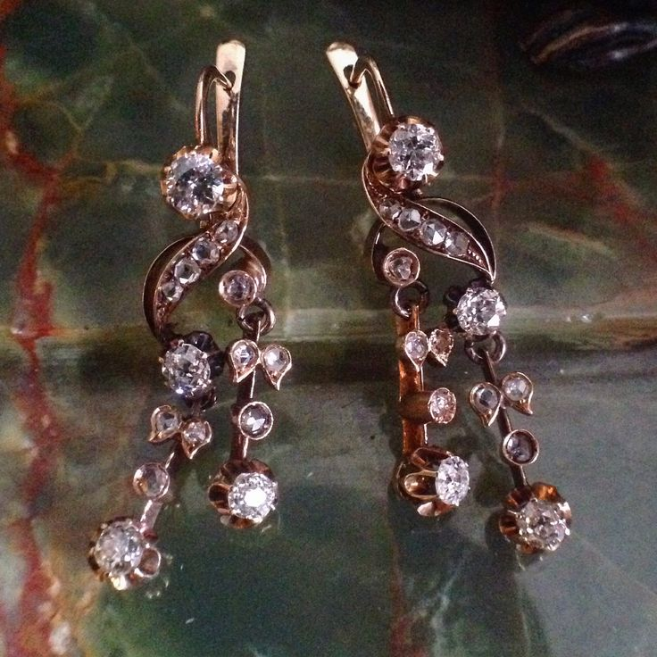 """Antique 14kt pink gold dangle/pierced earrings with a combination of mine cut and rose cut diamonds with interesting elements like knife's edge, scroll and buttercup settings for a delightful movement in the ear measuring 1-3/8"""" long, circa 1890 #Victorian#Victorianearrings#Victoriandiamondearrings#oldminecutdiamonds#rosecutdismonds#shopalexandriava#Antiquediamondearrings#rosegold#antiqueearrings#shopoldtownalexandriava#theantiqueguildalexandriava#oldtownalexandria#shopalexandriava"""