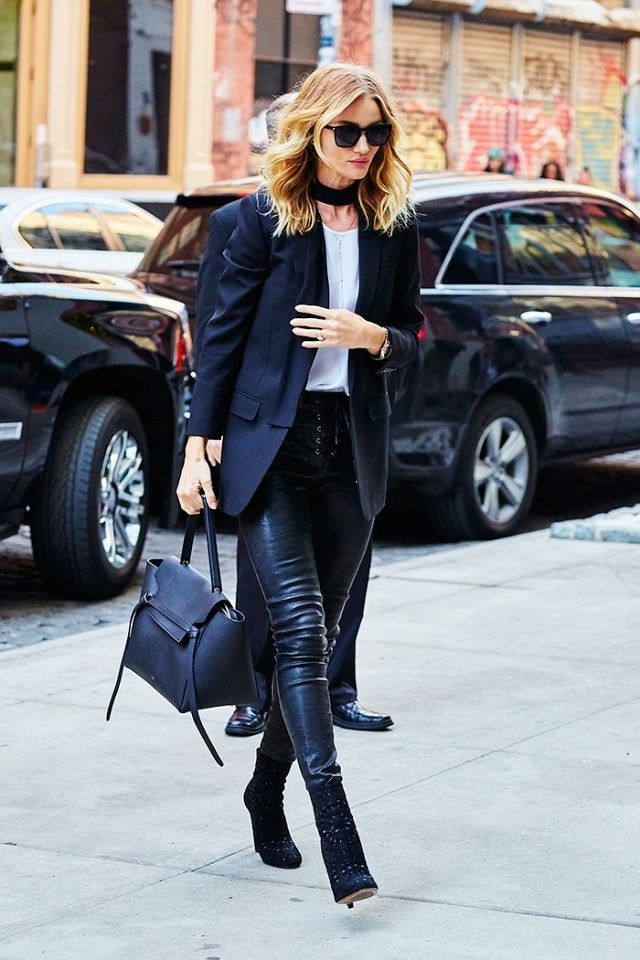 Rosie Huntington-Whiteley dresses up her blazer and tee look by replacing denim with leather pants and tying a skinny scarf around her neck