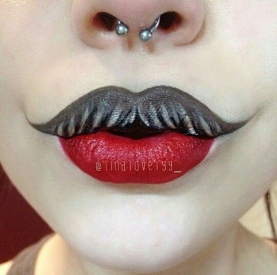 Love this twist on makeup with a mustache  and the septum piercing adds to it!