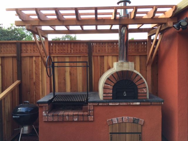 a rustic diy wood fired pizza oven and argentine grill with a traditional bbq grill in the back. Black Bedroom Furniture Sets. Home Design Ideas