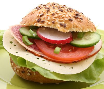 Tip: Cut 100 calories by pulling out some of the bread on the inside of your roll or bagel
