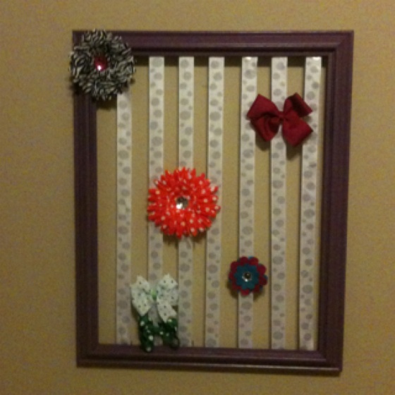 I made this bow holder out of an old picture frame! I painted the frame purple then glued(or stapled) the ribbon on!