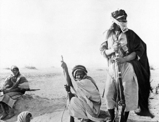 Three Bedouin warriors during the Arab Revolt, 1916-1918. They are armed with 1870s-vintage Martini-Henry rifles, typical of the outdated firearms the British supplied to the Arab forces.