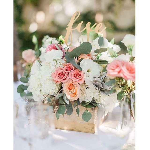 Low centerpiece in gold box wrapped lace coral white