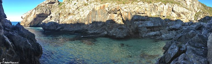 El Regolgueru cove in Ribadedeva, Asturias - panoramic view with El Arco del Caballo to the left.