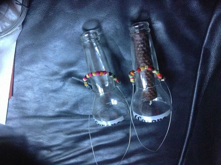 #Bottle, #Candle, #Glass, #Lights I used the acetone/string/cold water method of cutting some corona bottles (We have a good post on methods to cut glass bottles here). I then used some old wire from the shed and some beads in my craft stash to make hanging candle holders for